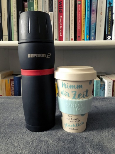 Thermos bottle with keep cup.