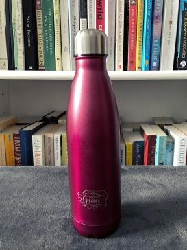 Purple water bottle.